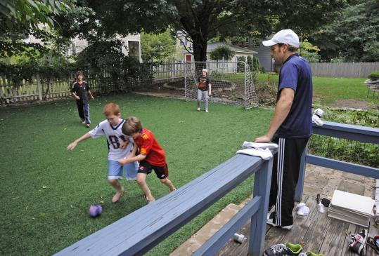 Backyard Turf Field :  patch of artificial turf he had installed in his Framingham backyard