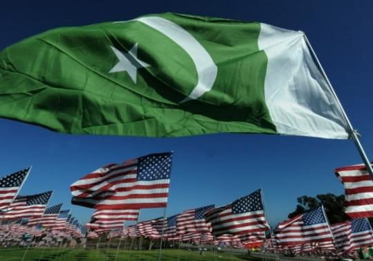 The Pakistani flag, representing a Muslim 9/11 victim from that country, flies with American flags at a Pepperdine memorial.