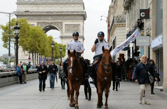 Mounted police officers patrolled the Champs Élysées in Paris yesterday amid the warning of potential terrorist attacks.