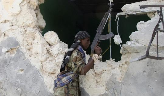 An Islamist fighter took a position yesterday during clashes with Somali government soldiers.