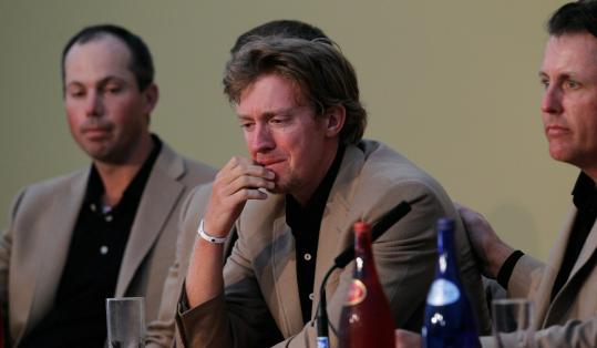 Phil Mickelson (right) was one of many teammates to speak favorably of and console Hunter Mahan (middle) — who lost to Graeme McDowell, 3 and 1, in the final singles match — after the conclusion of the Ryder Cup.