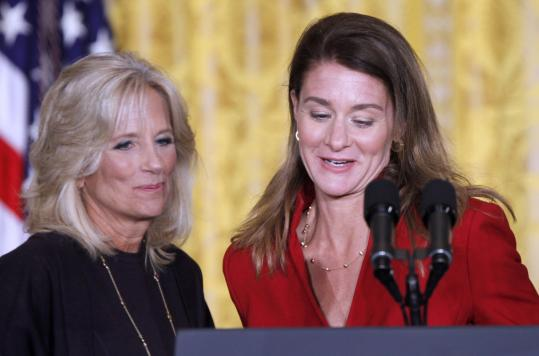 Jill Biden (left), wife of Vice President Joe Biden, and Melinda Gates, cofounder of the Bill & Melinda Gates Foundation, at the White House Summit on Community Colleges yesterday.