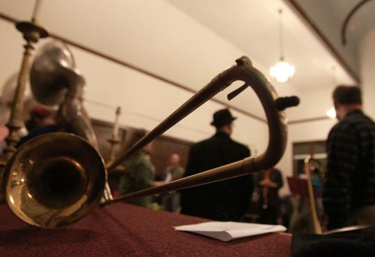 The Second Line Social Aid & Pleasure Society Brass Band rehearses at a Somerville church.