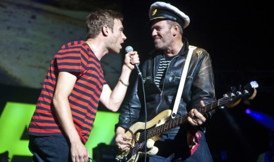 Damon Albarn (left) and Paul Simonon performing as Gorillaz.