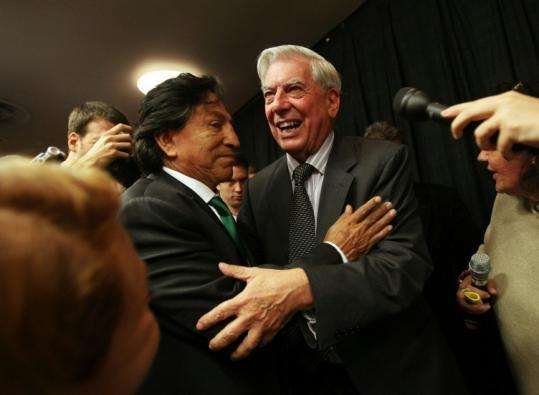 Mario Vargas Llosa (right) was congratulated by Peru's former president, Alejandro Toledo, in New York yesterday.