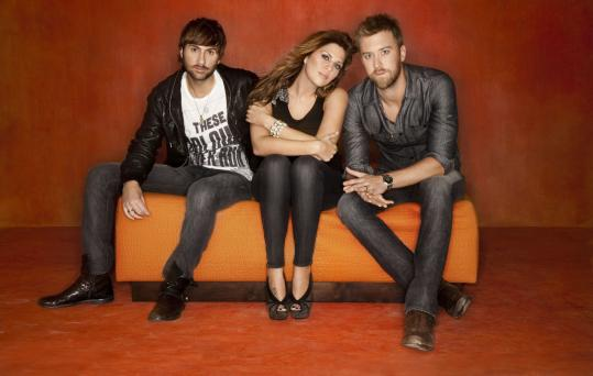 The country trio Lady Antebellum (from left: Dave Haywood, Hillary Scott, and Charles Kelley) is on its first headlining tour.