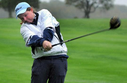 Mary Mulcahy, 16, of Scituate, takes a few swings at the Hatherly Golf Club course behind her house.