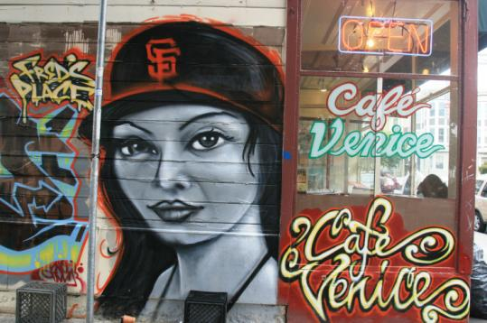 A mural on the side of Cafe Venice in the Mission District of San Francisco.