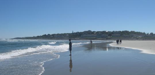 Ogunquit Beach is a sandy barrier between the ocean and the Ogunquit River.