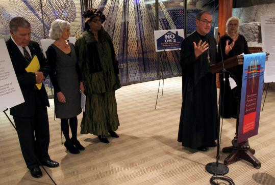 Bishop Thomas Shaw of the Episcopal Diocese of Massachusetts spoke alongside representatives of other faiths yesterday.