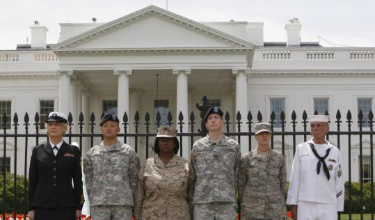 Members of various branches of the military handcuffed themselves to the fence outside the White House in April as they demonstrated in favor of gay rights.