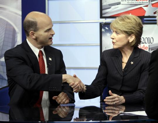 "James P. McKenna and Attorney General Martha Coakley before a Sept. 30 debate. Despite her huge financial advantage, the incumbent said, ""I'm taking this race very seriously.''"