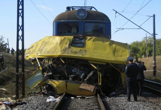 Police officers examined the wreckage of a bus after it was hit by a train in Ukraine's Dnipropetrovsk region yesterday.