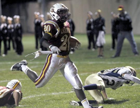 Cardinal Spellman High running back Blaise Branch runs for one of his four touchdowns against Coyle & Cassidy last Friday.