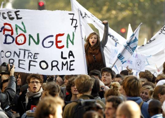 French high school students shouted slogans during a demonstration in Paris yesterday against President Nicolas Sarkozy's plan to change the nation's pension system.