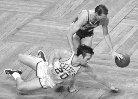 Larry Siegfried dove for a loose ball while defending the Lakers' Jerry West in Game Five of the 1968 NBA Finals in Boston.