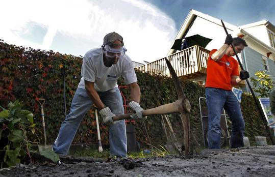 Frank Moore, left, and Steven Nutter chopped pavement in Nutter's backyard Monday.