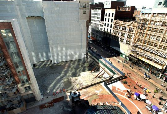 There has been a gaping hole at the site of the former Filene's at Downtown Crossing since June 2008 when a planned development stalled during the economic downturn.
