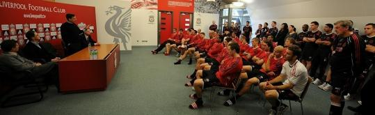 Tom Werner (standing) addresses the Liverpool players yesterday. John Henry is to his right.