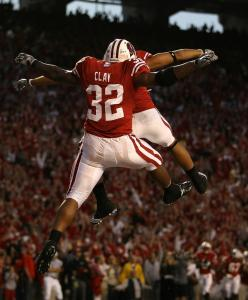John Clay celebrates one of his two rushing touchdowns with Nick Toon as Wisconsin stunned Ohio State.