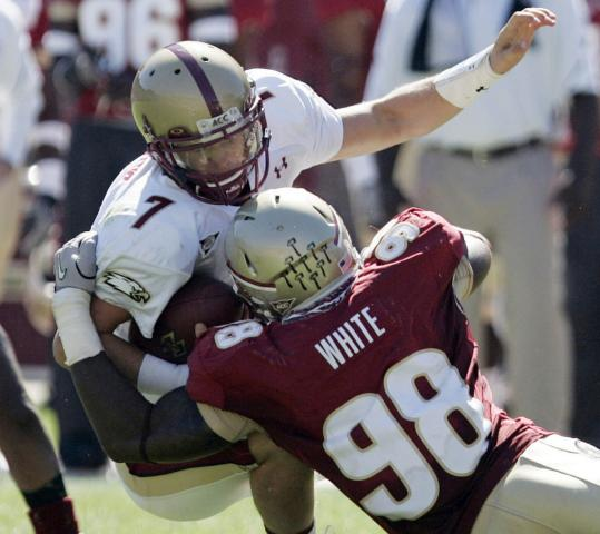 Chase Rettig is slammed down by FSU's Markus White, one of four sacks for the Seminoles.