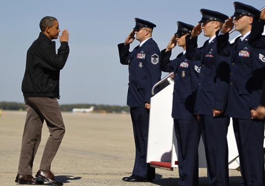 President Obama saluted before boarding Air Force One in Washington to travel to Ohio for midterm election campaigning.