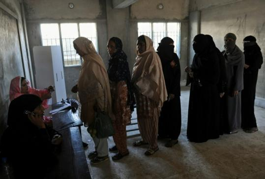 Women cast their ballots in an election in Karachi, Pakistan, to replace a lawmaker who was killed in August.