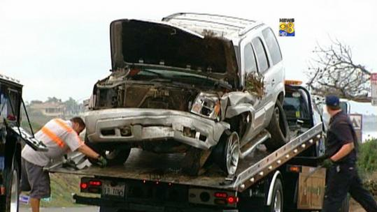 Junior Seau's Cadillac SUV was found on the beach about 100 feet below the roadside in Carlsbad, Calif. Seau earlier had been arrested on suspicion of domestive violence.