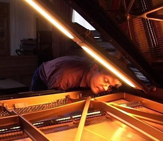 Stefan Knüpfer, master tuner for Steinway & Sons in Austria, tunes a piano before a recording.
