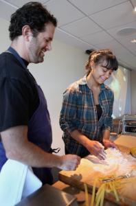 Chef Tony Maws watches as Carmen Morales makes pasta.