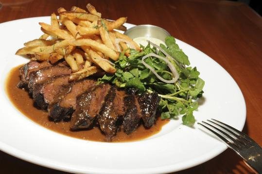 Steak frites offer slices of medium rare hanger steak and perfect pommes frites.