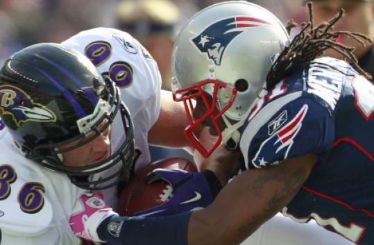 Patriots safety Brandon Meriweather, right, was fined for his tackle of Ravens tight end Todd Heap.