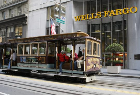 Wells Fargo said fewer customers defaulted on loans. Losses from bad loans were $4.1 billion in the third quarter, down 20 percent from the third quarter of 2009.