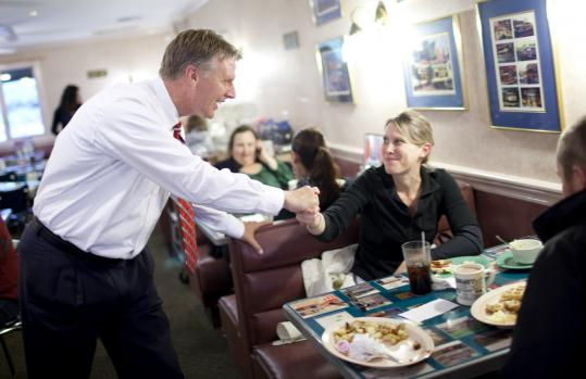 Timothy P. Cahill greeted Sara Cleveland and other customers at the Owl Diner as he campaigned in Lowell.