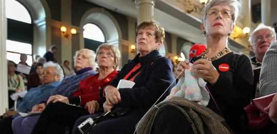 Joan LaRowe from Great Island, an over-55 community in Plymouth, knitted and listened intently to the candidates.