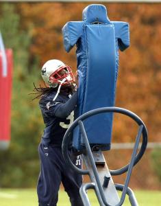 "Brandon Meriweather, $50,000 poorer these days, vows to tackle ""the proper way,'' as players are instructed in practice."
