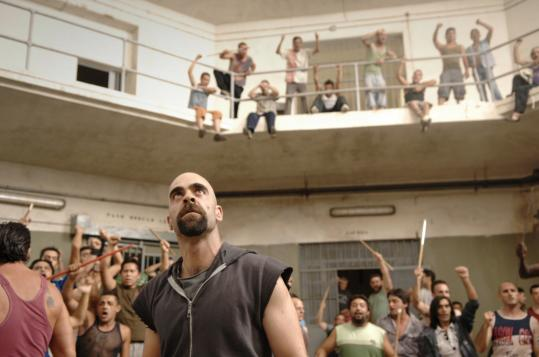 "Luis Tosar (center) plays Malamadre, the leader of a prison riot that sparks a second melee outside the gates in ""Cell 211.'' The film, directed by Daniel Monzón, won eight Spanish Goya Awards."