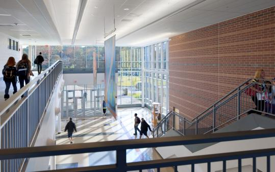 The interior of the new Newton North High School, which opened last month, is awash in light and connected by a single corridor more than 1,000 feet long.