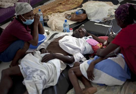 Patients with cholera received medical attention at St. Nicholas Hospital. The emergence of cholera in Haiti had been feared since the first days after January's earthquake.