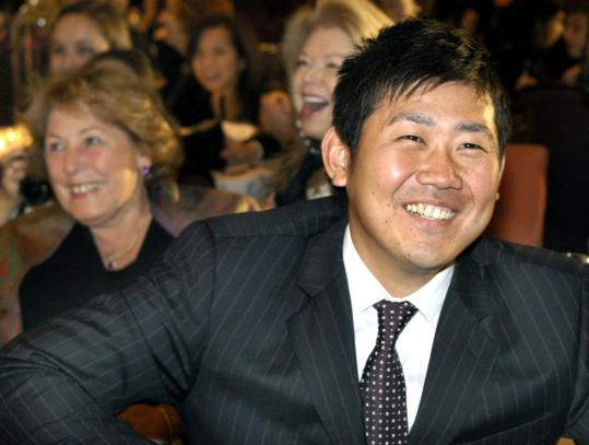 Daisuke Matsuzaka at the Silk Road Gala. In the background, Angela Menino (left) and Mary Kakas.
