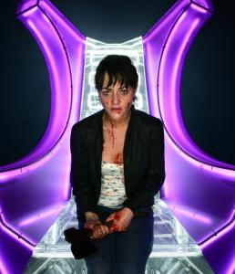 Jaime Winstone plays a TV assistant trying to make it to safety.