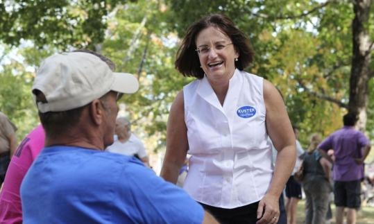 Democrat Ann McLane Kuster (left) and Republican rival Charlie Bass are in an intense battle to win a New Hampshire seat in the US House.