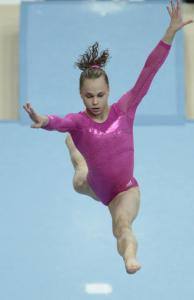 Rebecca Bross of the United States performs during the beam final en route to a silver medal at the World Championships