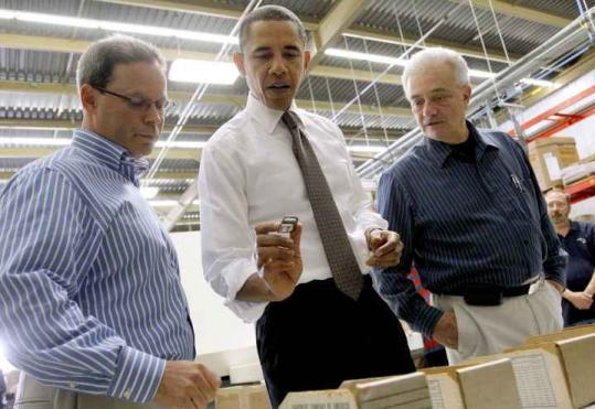 President Obama in Woonsocket, R.I., yesterday, with factory owner Mark Krauss (left) and plant manager Ray Velino.