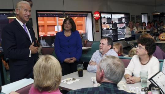 A REGULAR JOE — Vice President Joe Biden campaigned for Ann McLane Kuster, to his left, at a diner in Nashua yesterday. Kuster is running in the 2d Congressional District against Republican Charlie Bass, a former US representative.