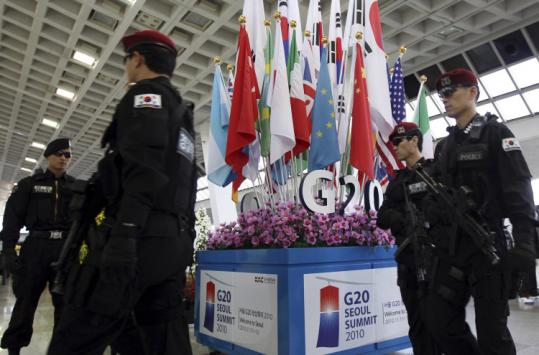 South Korean special police officers patrolled near a Group of 20 symbol at Gimpo Airport in Seoul yesterday.