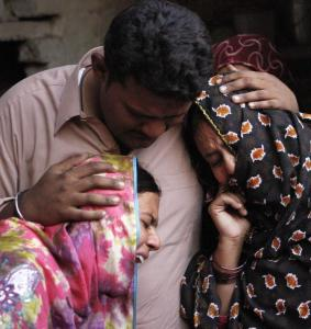 A victim's relatives grieved after a bomb attack at a Sufi shrine in Pakistan's Punjab. Islamist militants often target the sect.