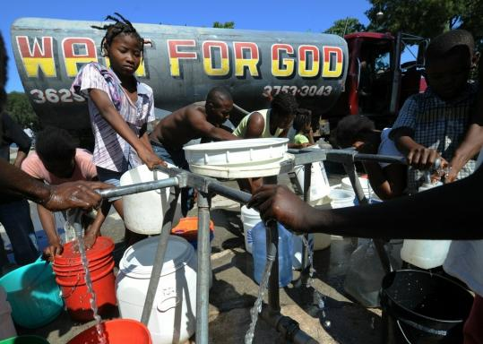 Potable water was distributed yesterday near a tent city outside Port-au-Prince in an effort to stem a cholera outbreak that has killed at least 259 people in a rural region about 45 miles away.