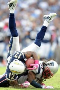 Putting his shoulder into it, Brandon Meriweather takes down Patrick Crayton with a hard tackle.