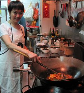 Making mapo tofu in the kitchen at Da Ping Huo.